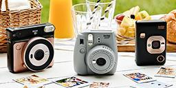[photo] 3 Instax cameras on a table with decor