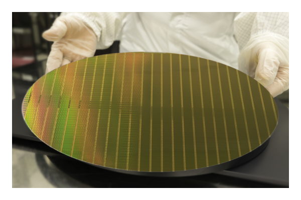 man holding silicon wafer