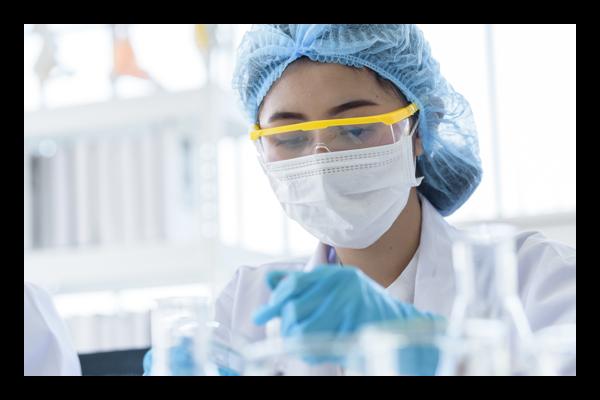 Women working in lab wearing safety equipment