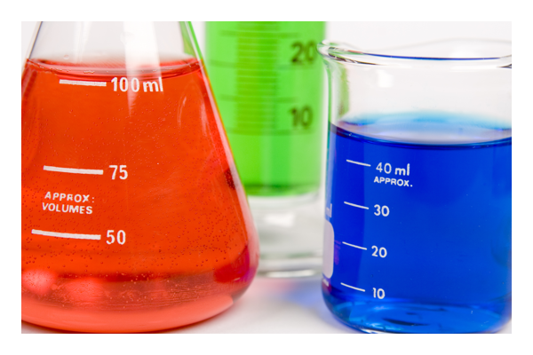 Three beakers filled with Red, Green, and Blue liquids