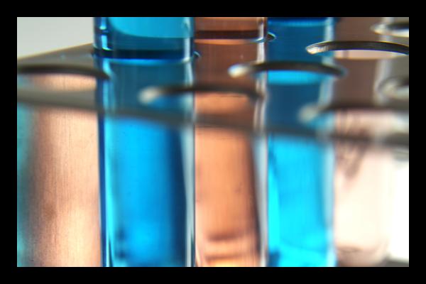 Two vials of blue liquid in vial rack